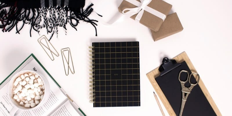 The best tools for bloggers blog traffic header image of black and brown notepads and stationary