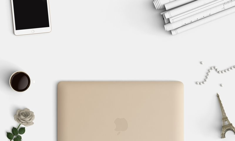 How To Choose A WordPress Theme Header Image Of Golden Mac Laptop Smartphone